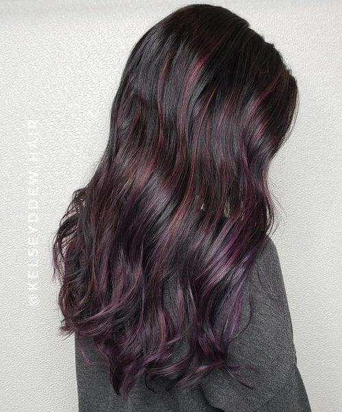 Vibrant Black Cherry Highlights on Dark Hair