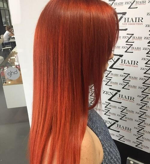 A long warm red hair color