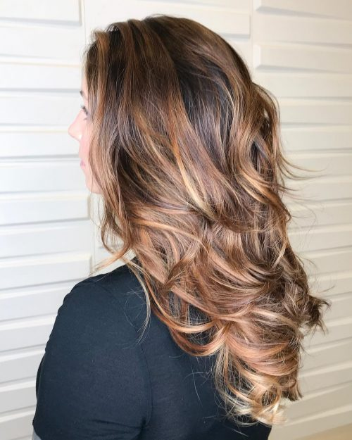 Picture of a voluminous dimensional waves a long simple hairstyle