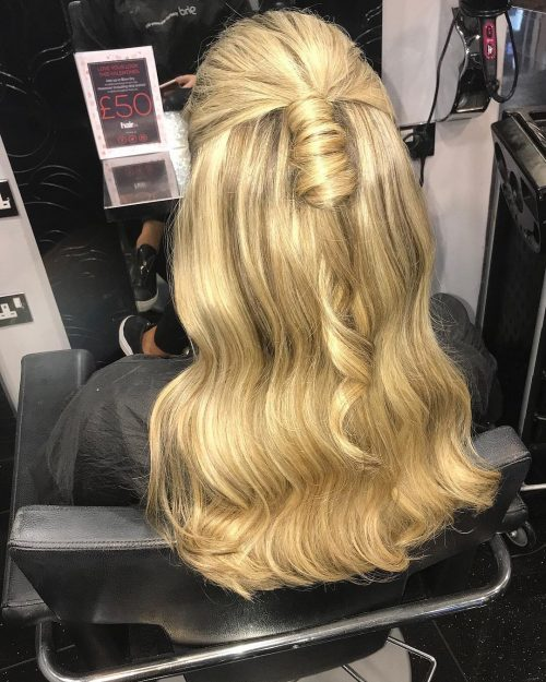 Picture of a wavy half up evening hairstyle